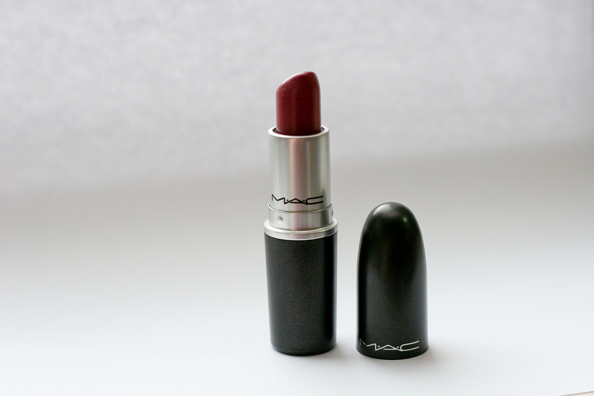 MAC lipstick in Capricious, which has a lustre finish, is part of MAC's permanent collection. It has MAC's standard black packaging.