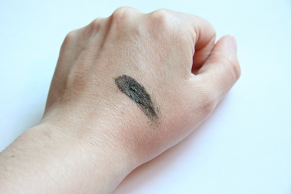 MAC Opulash Mascara in Bad, Bad Black, swatched on my hand. As you can see, it's certainly black—but I don't see anything extra-black about it.