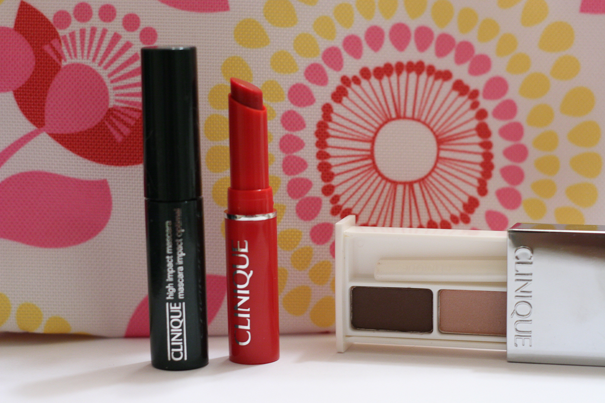 High Impact Mascara, Almost Lipstick in Luscious Honey, and All About Shadow Duo in Day into Date. Everything came in the fun cosmetic bag pictured in the background.