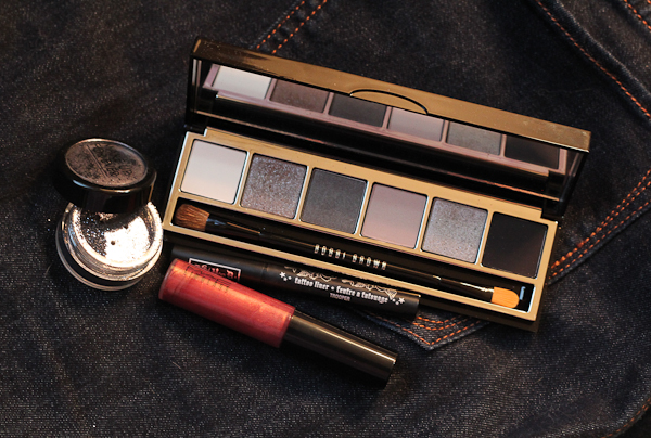 My picks for a New Year's Eve look: Make Up For Ever's Glitter in Gunmetal, Bobbi Brown's Smokey Cool Eye Palette, Kat Von D Tattoo Liner in Trooper, and MAC Lipglass in Hellbound.