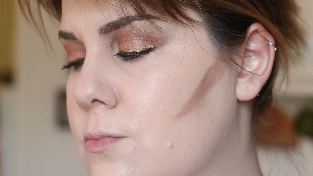 Here, I've applied a stripe of the contour shade to the hollows of my cheeks.