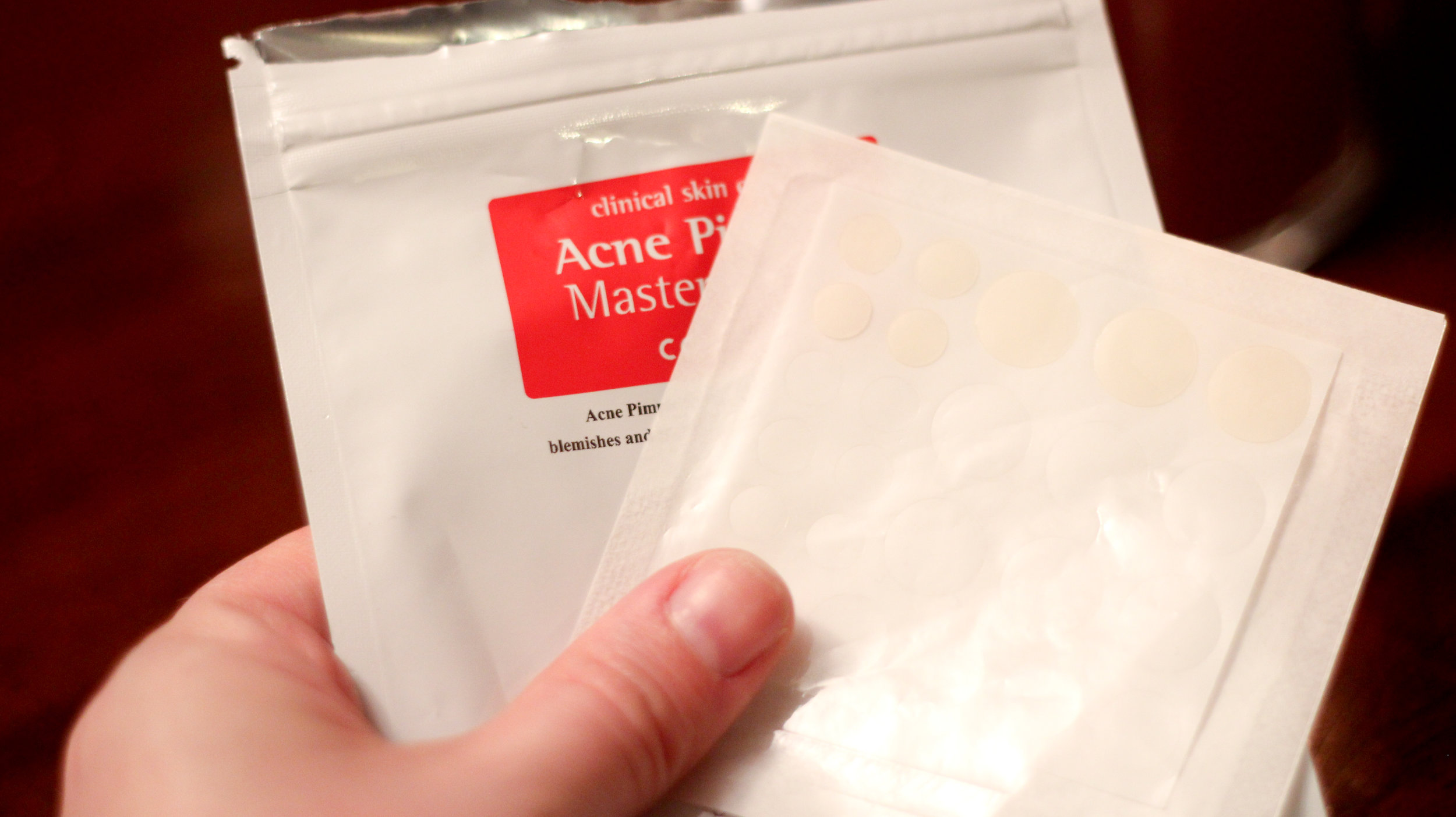 One envelope of Acne Pimple Master Patches by COSRX (partially used).