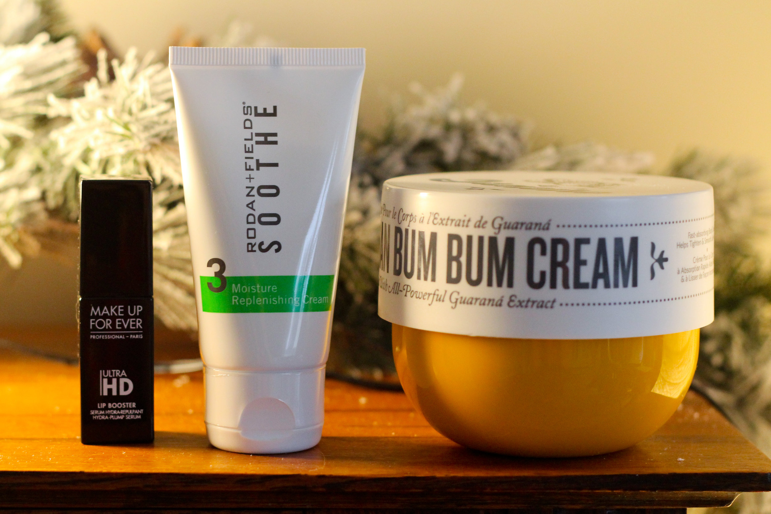 Left to right: Make Up For Ever Lip Booster in 01, Rodan + Fields SOOTHE Moisture Replenishing Cream, and Sol de Janeiro Brazilian Bum Bum Cream.