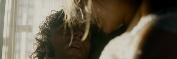 Oscar Isaac and Elizabeth Olsen in In Secret {Photo: ROADSIDE ATTRACTIONS}