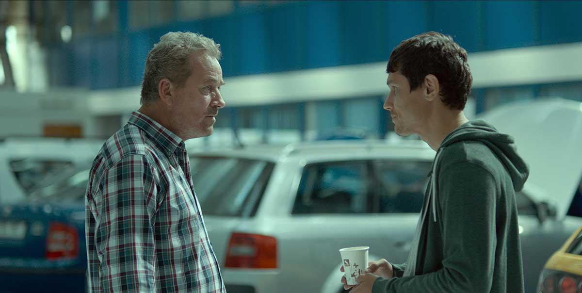 Teodor Corban and Iulian Postelnicu in a scene from Radu Muntean's  One Floor Below  {Photo: FILM BOUTIQUE}