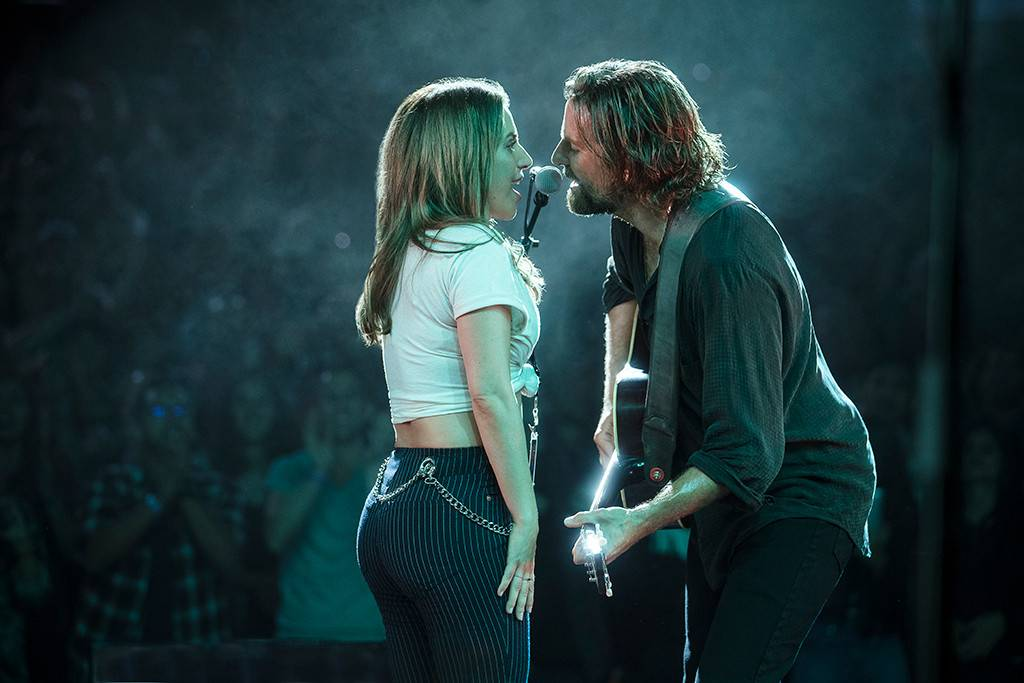Lady Gaga and Bradley Cooper in a scene from  A Star is Born  {Photo: Warner Bros. Pictures}