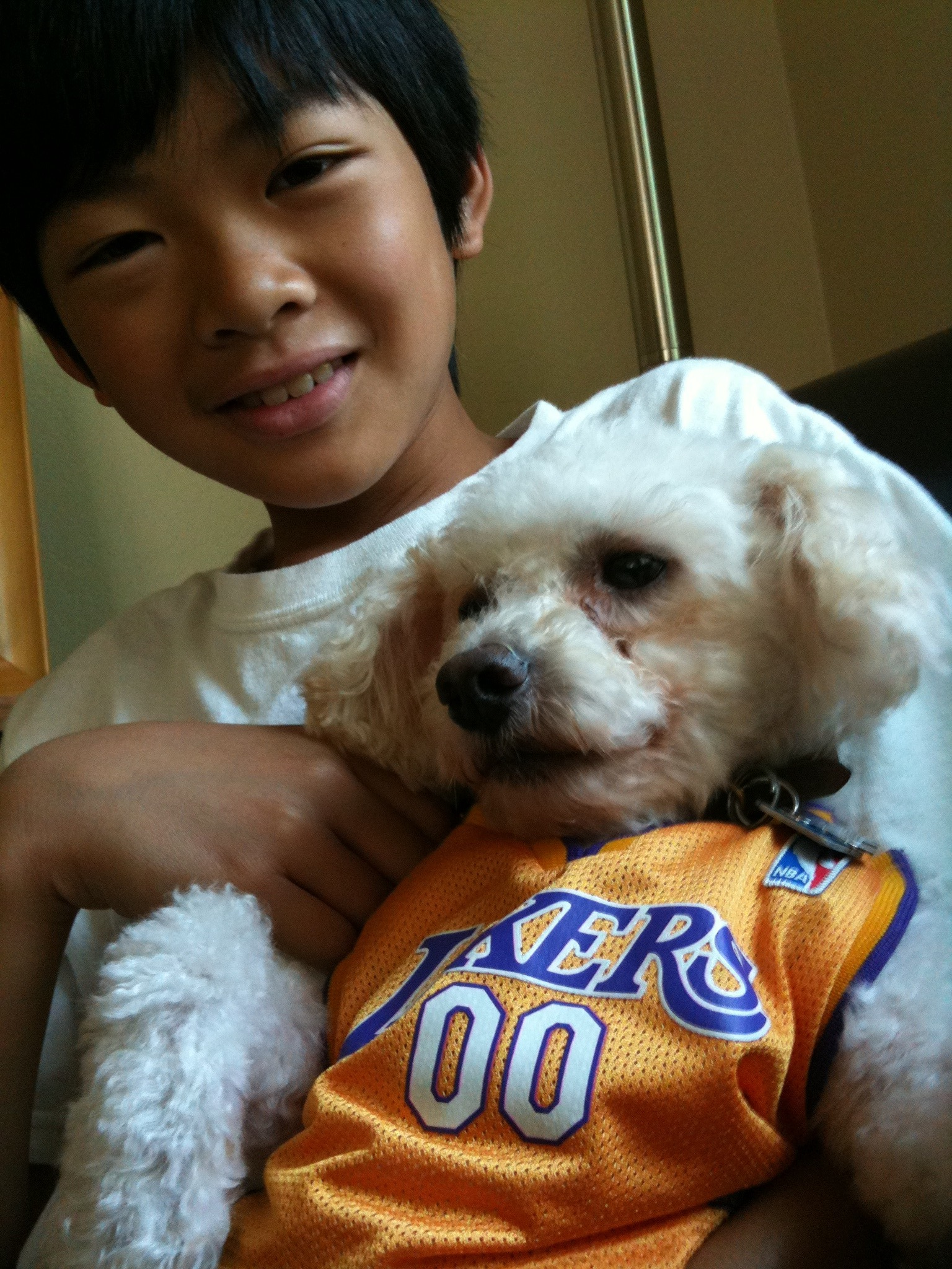The boy and the dog are ready for the NBA Finals.