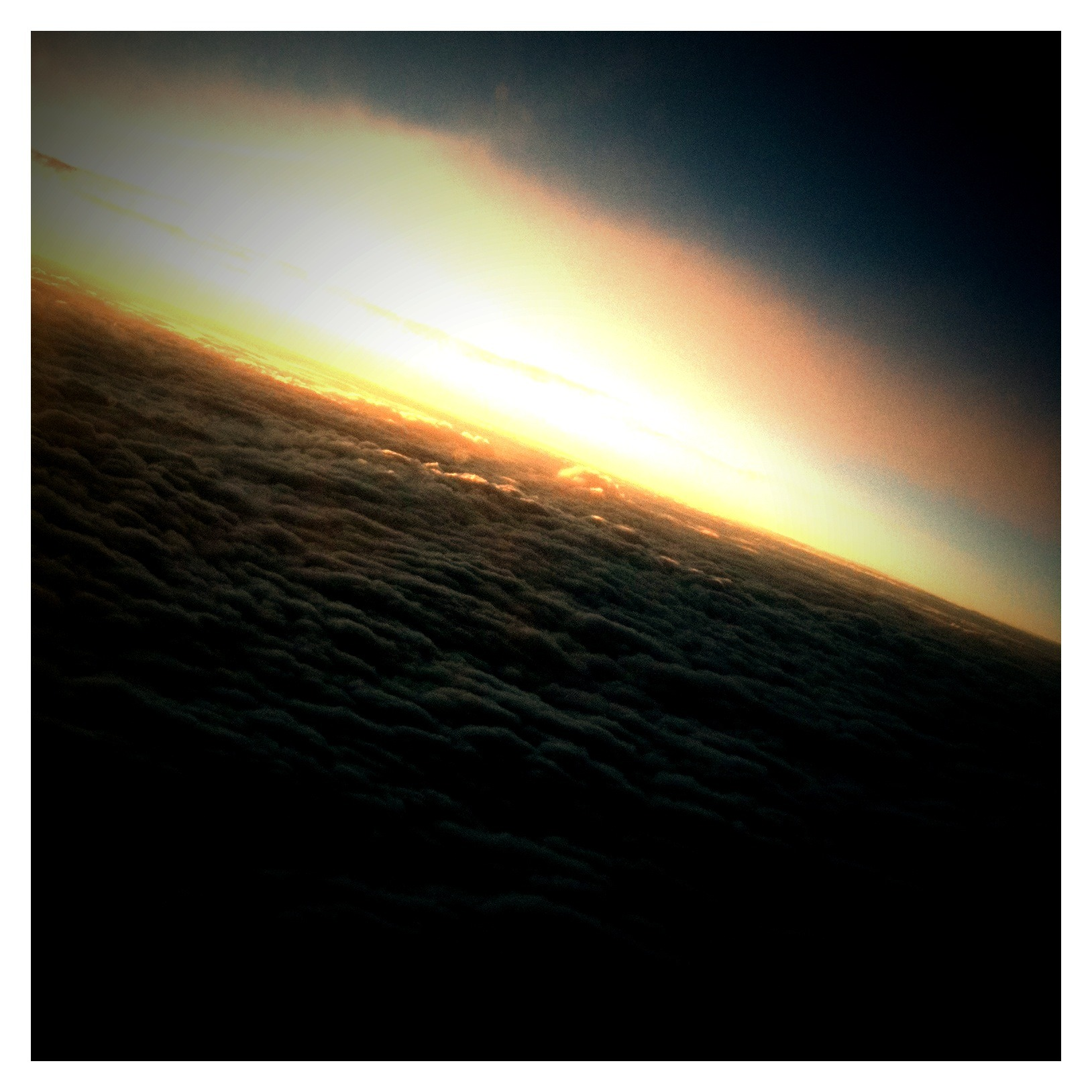 A few shots of clouds/sunset from the plane.