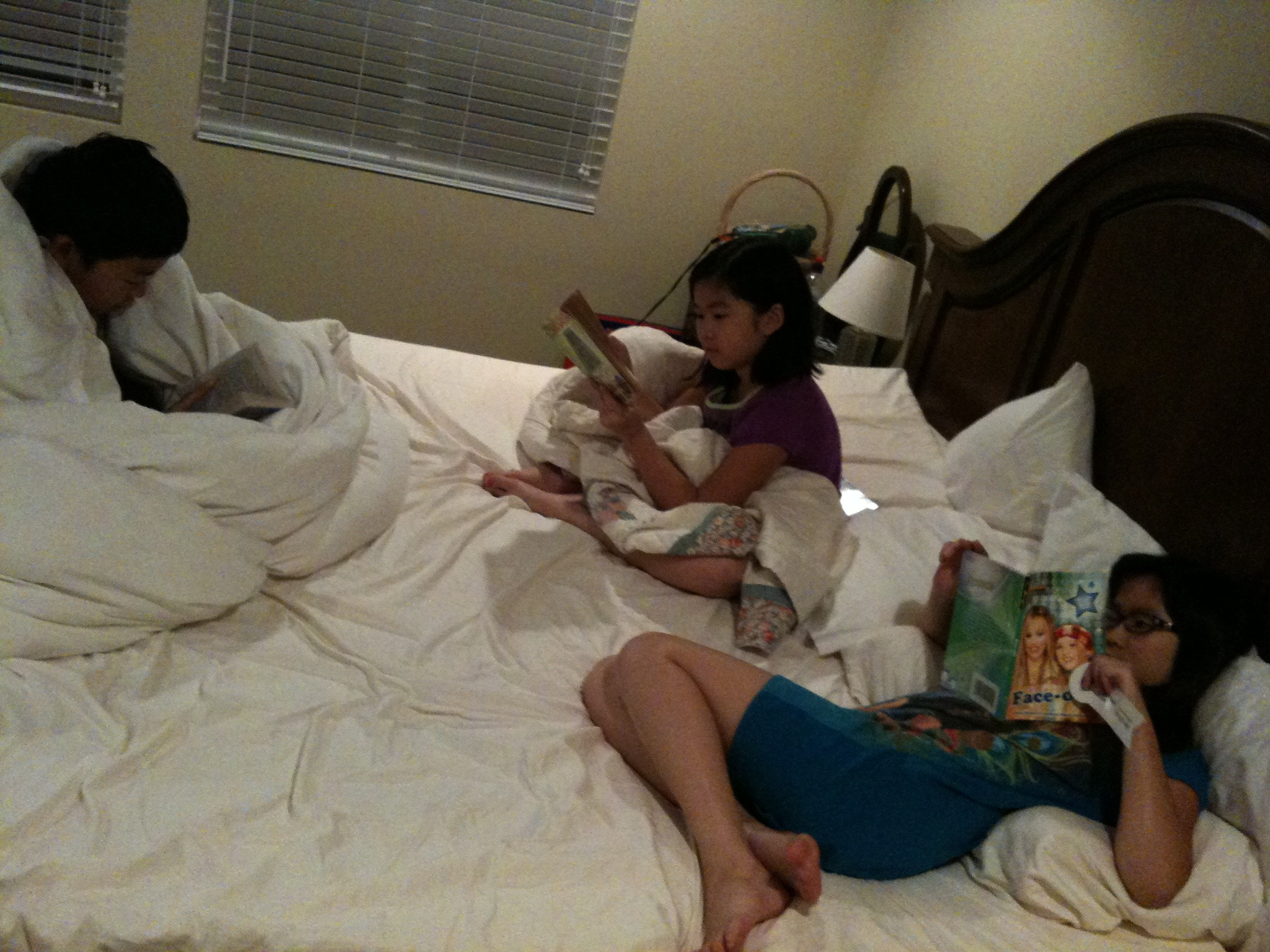 The girls and coccoon boy reading their bedtime stories.