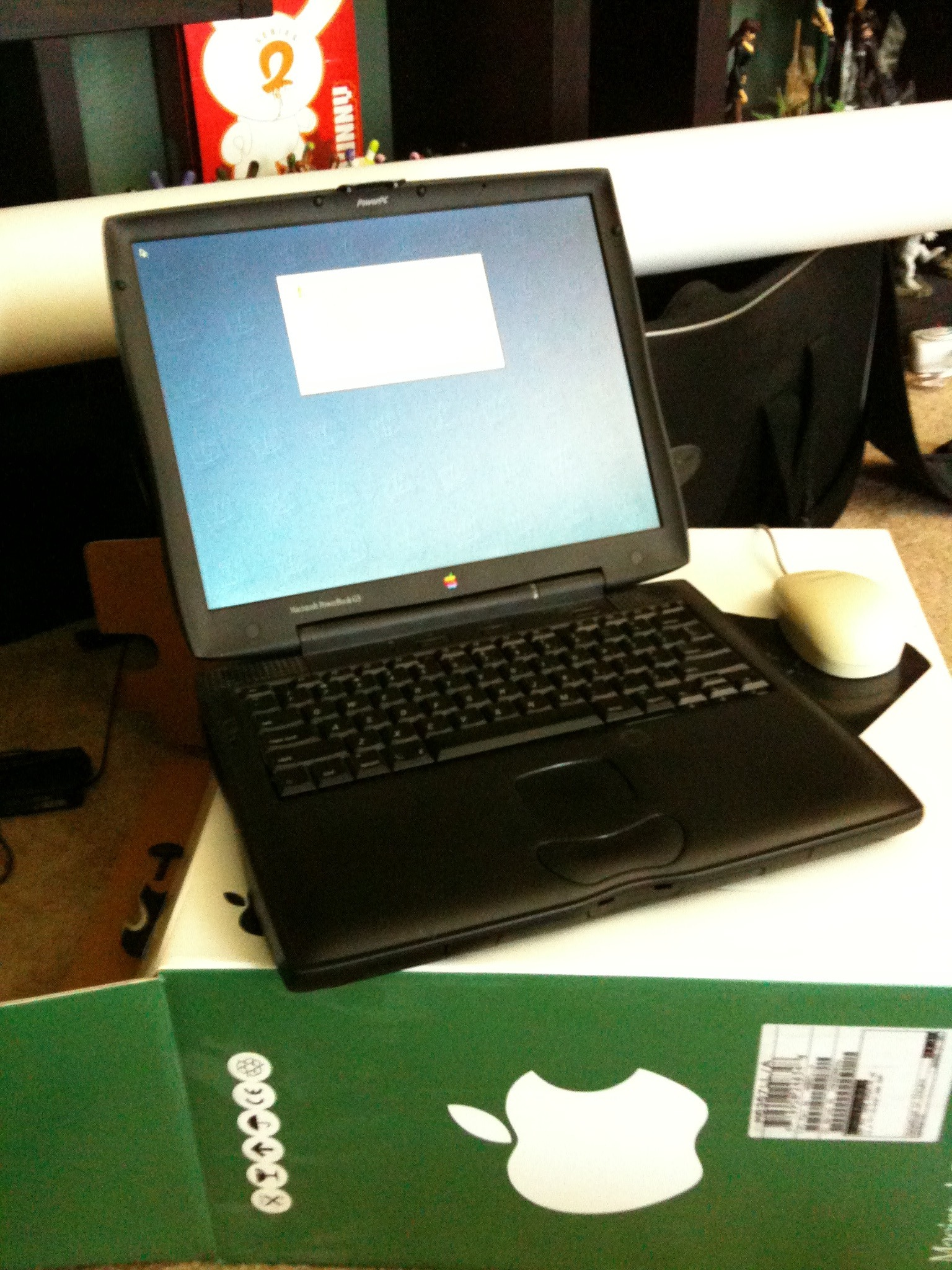 Wiping out an old school PowerBook to give to charity.