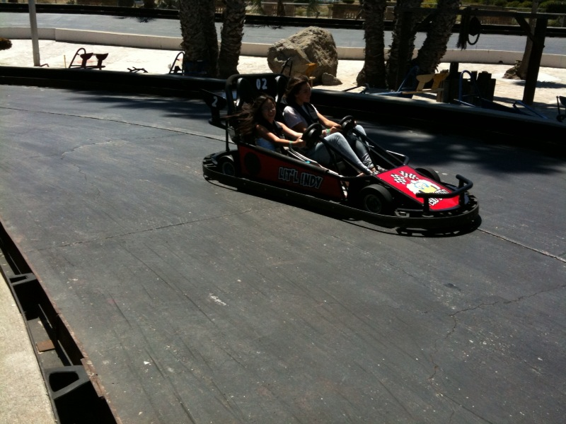 The boy finally drives a go kart on his own. The girls use their cousins.