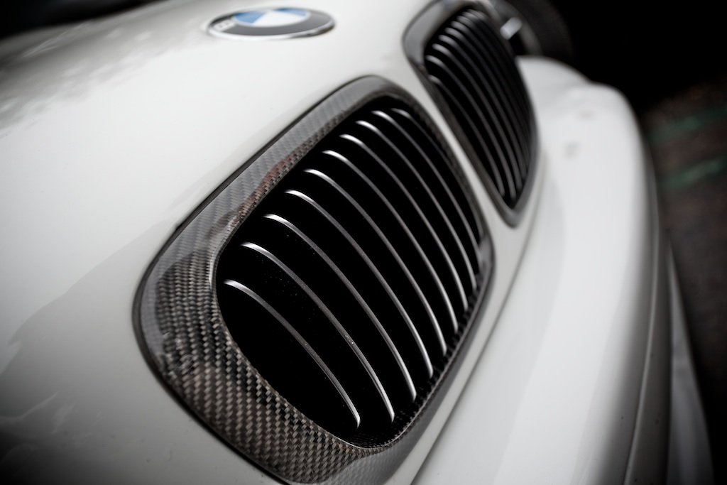 A coupla nice M3's decked out with Carbon Fiber at Cars & Coffee