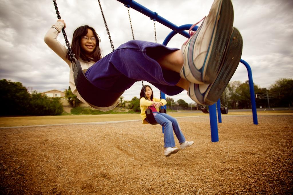 Twins on Swings
