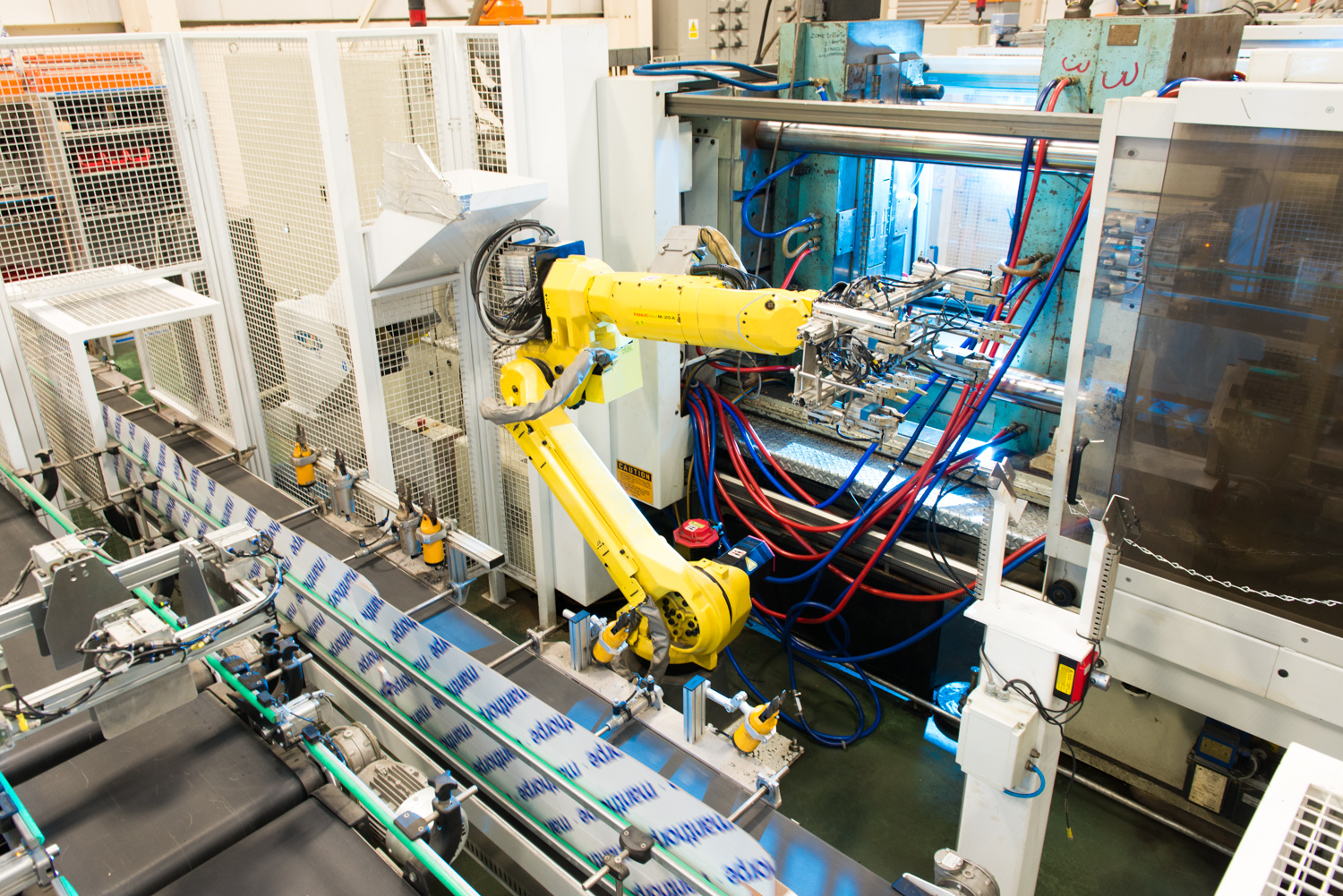 These robotic arms move incredibly fast! This one plucks a plastic part, rotates and attaches other parts, and places it in a chute for packaging.
