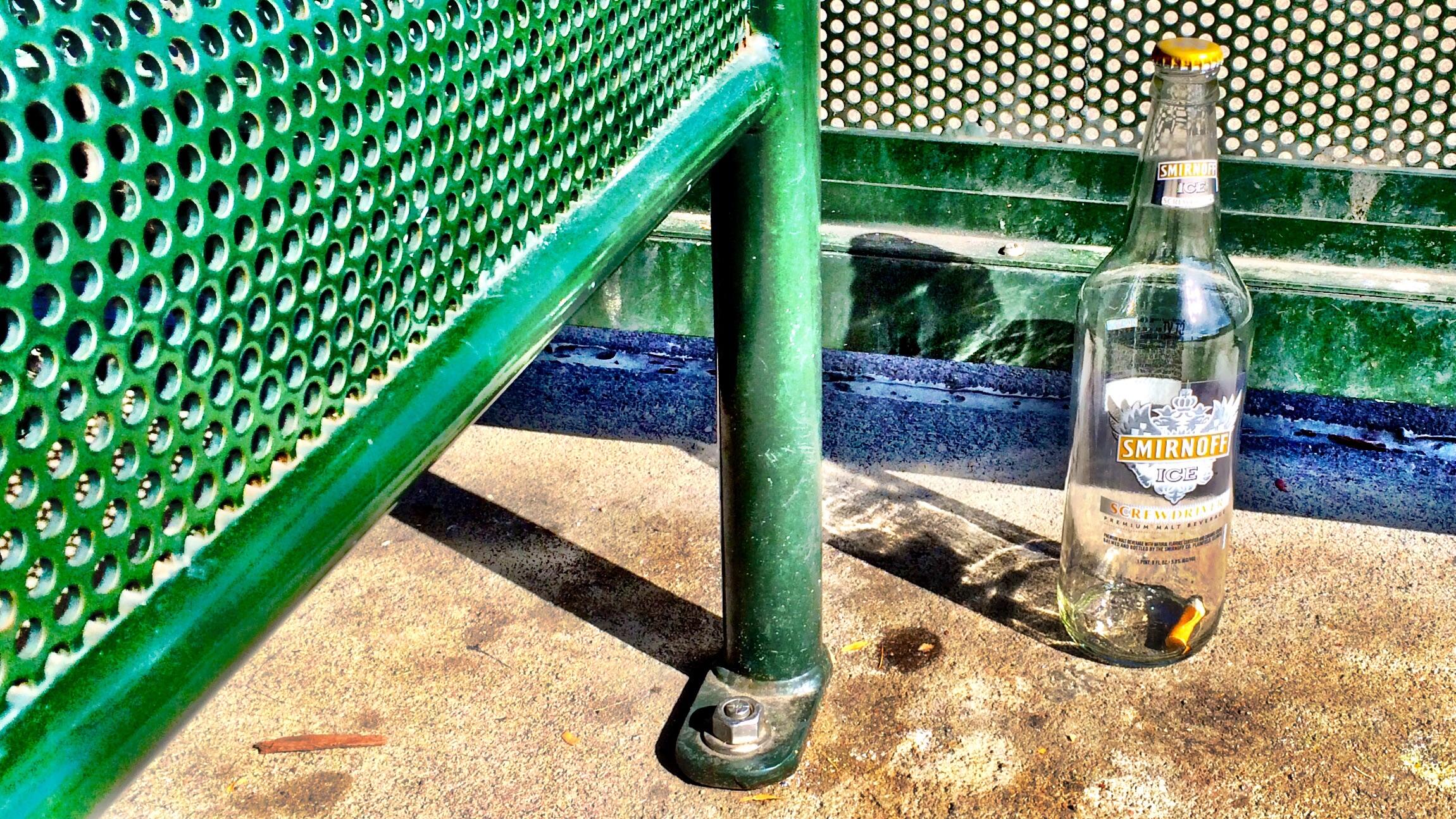 Smirnoff Ice bottle at a bus stop in Aurora, CO