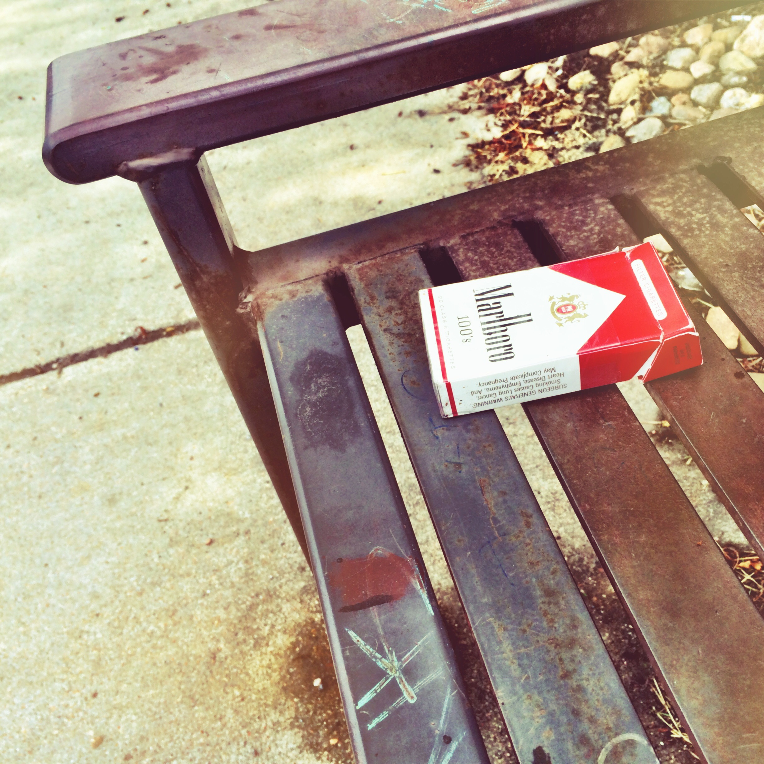 Butts at a bus stop - Marlboro Reds