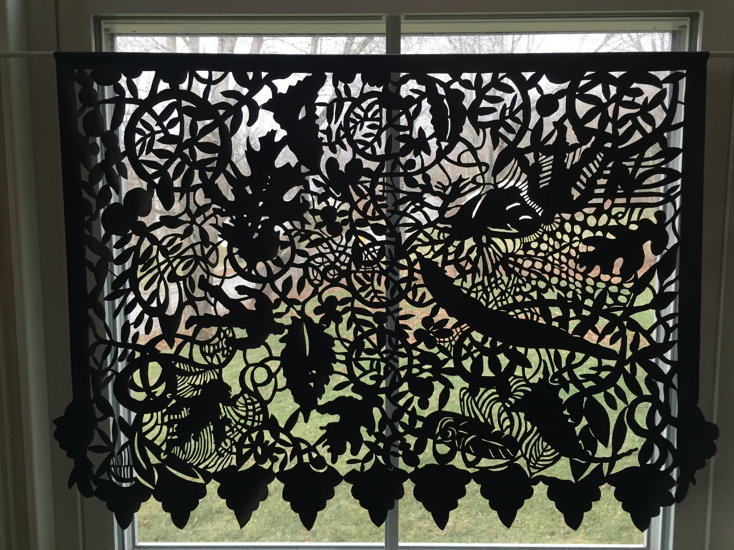 This is hanging in my dining room window   cut muslin and ink  2014