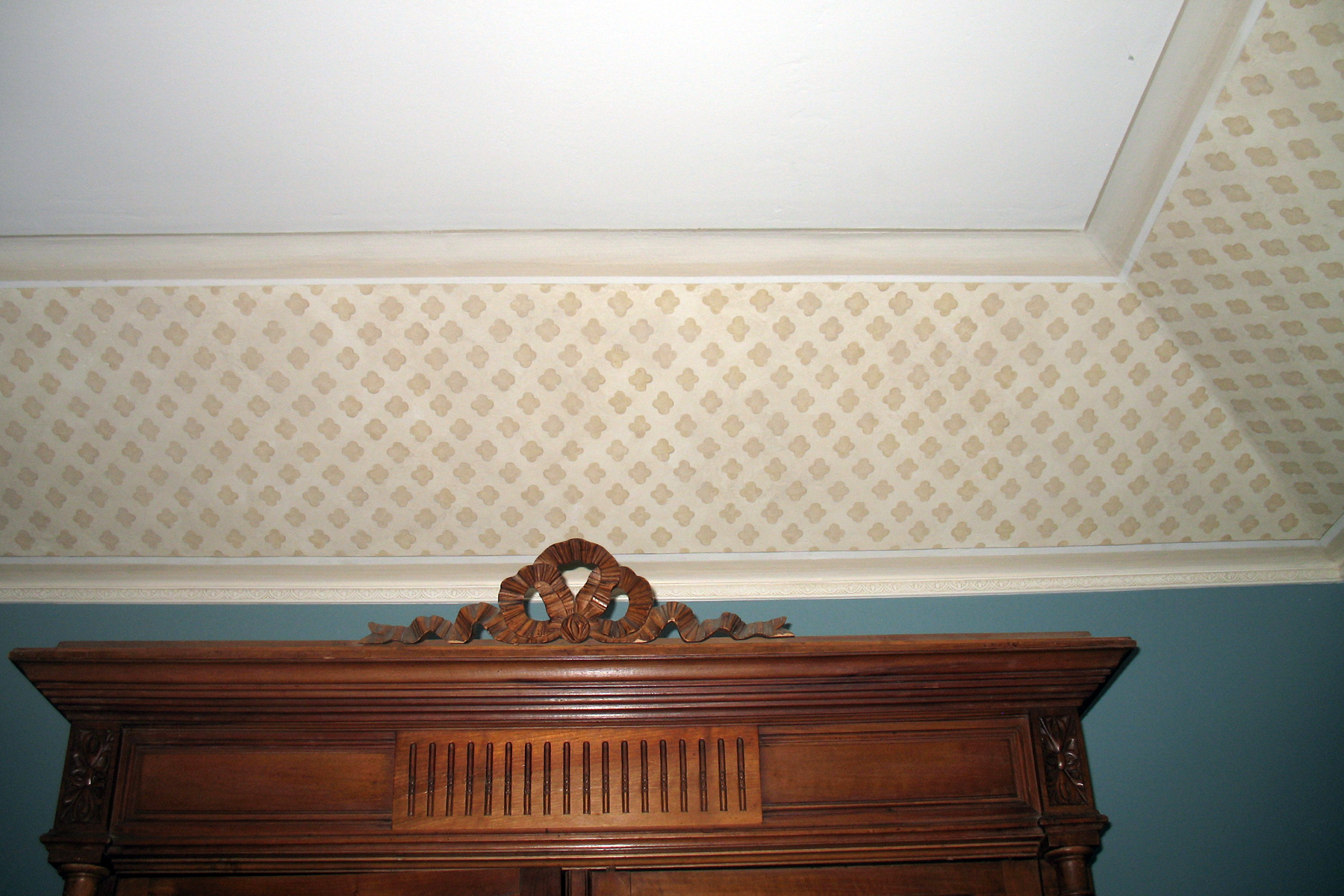 HAND PAINTED DESIGN ON ANGLED CEILING