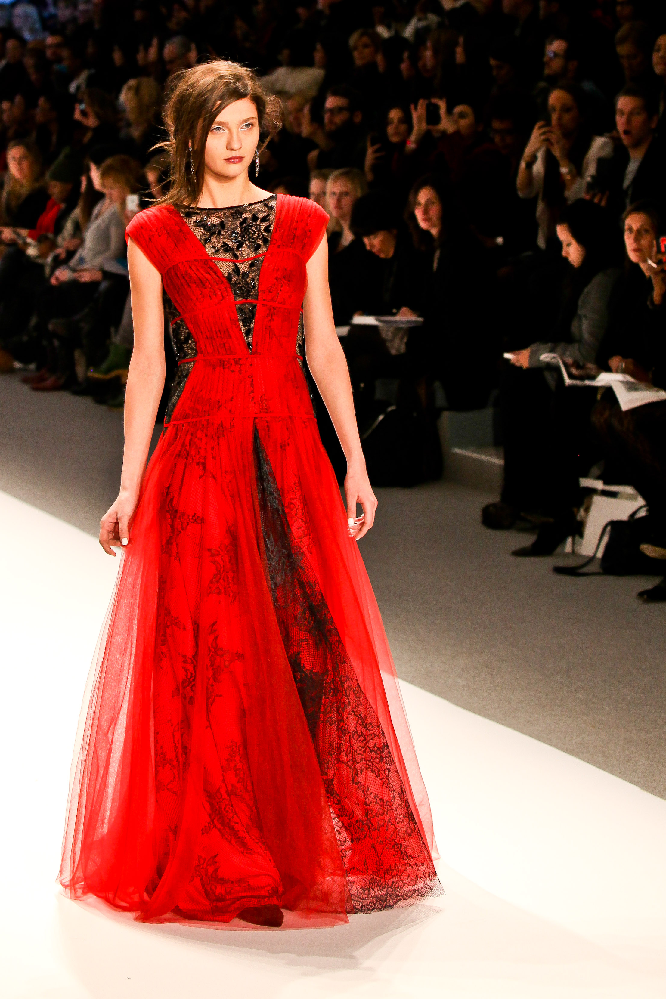 NEW YORK - FEBRUARY 07:A model walks the runway at the  Tadashi Shoji  Fall 2013 collection Mercedes-Benz Fashion Week in New York on February 07 2013.