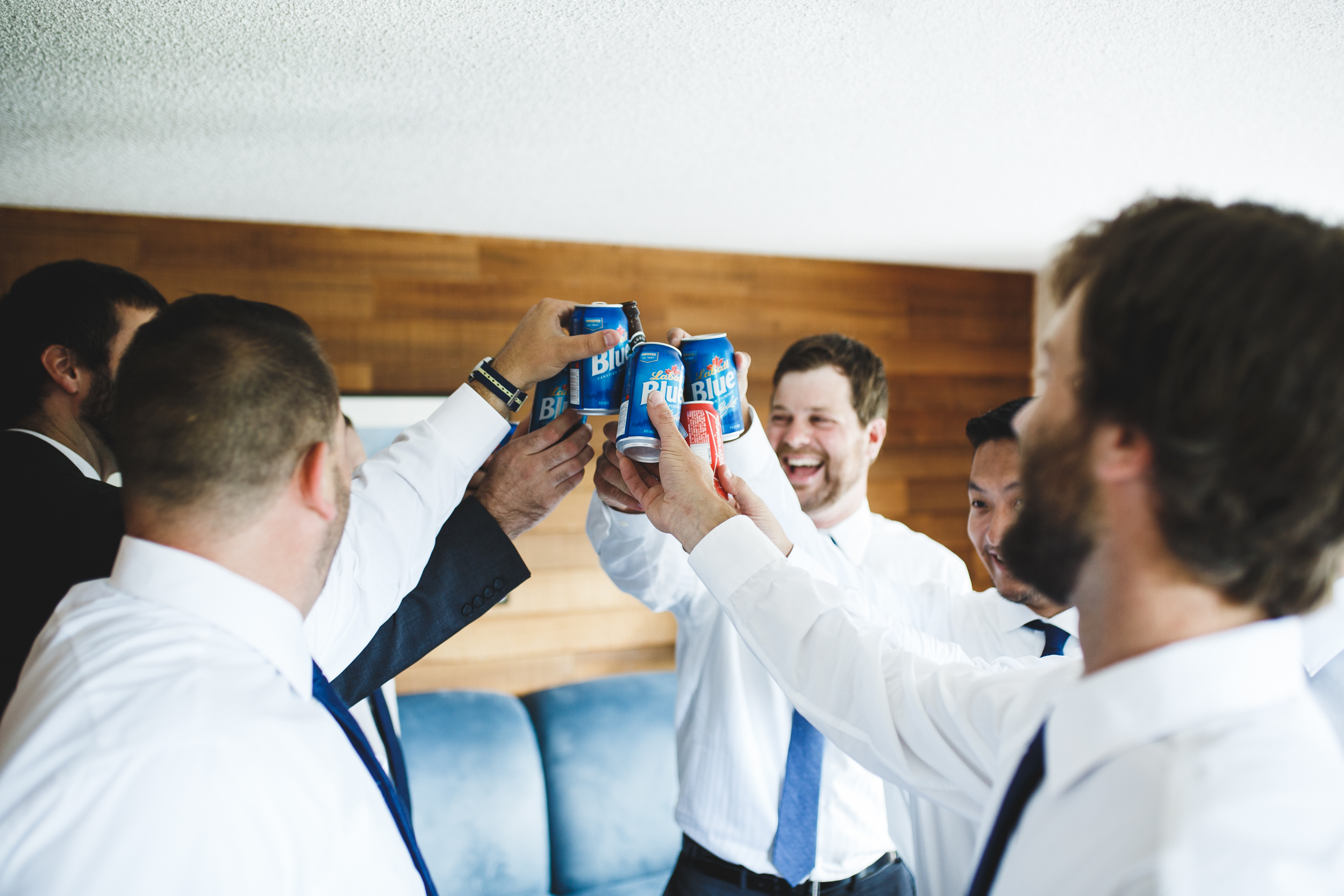 Toast with groomsmen in Smugglers Notch Resort, Vermont.