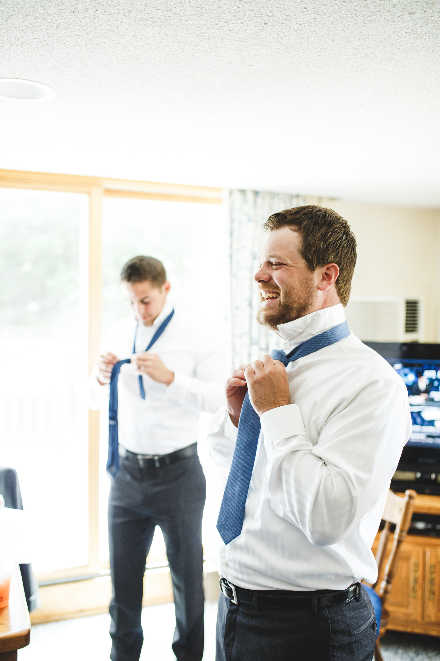 Groomsmen getting ready at Smugglers Notch Resort in Vermont.