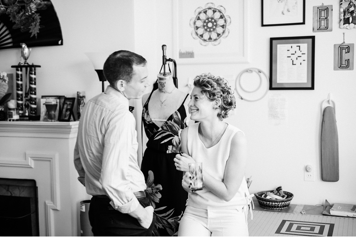 couple laughing together during in home engagement session Boston MA