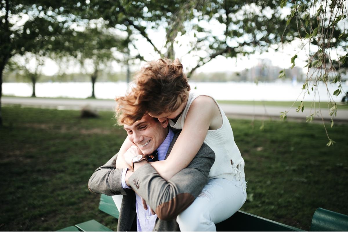 woman hugging man over shoulders in Boston park