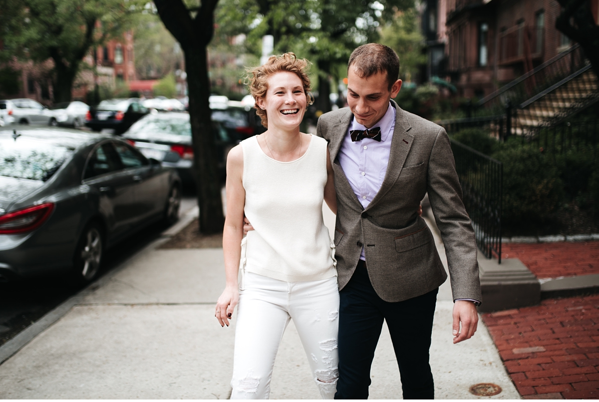well dressed couple walking down Beacon st in Boston MA