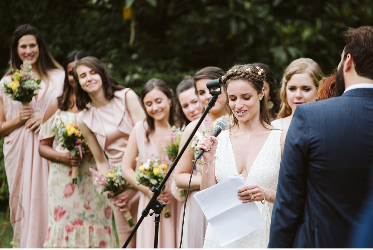 Bride reading vows during outdoor ceremony at Willowwood Arboretum