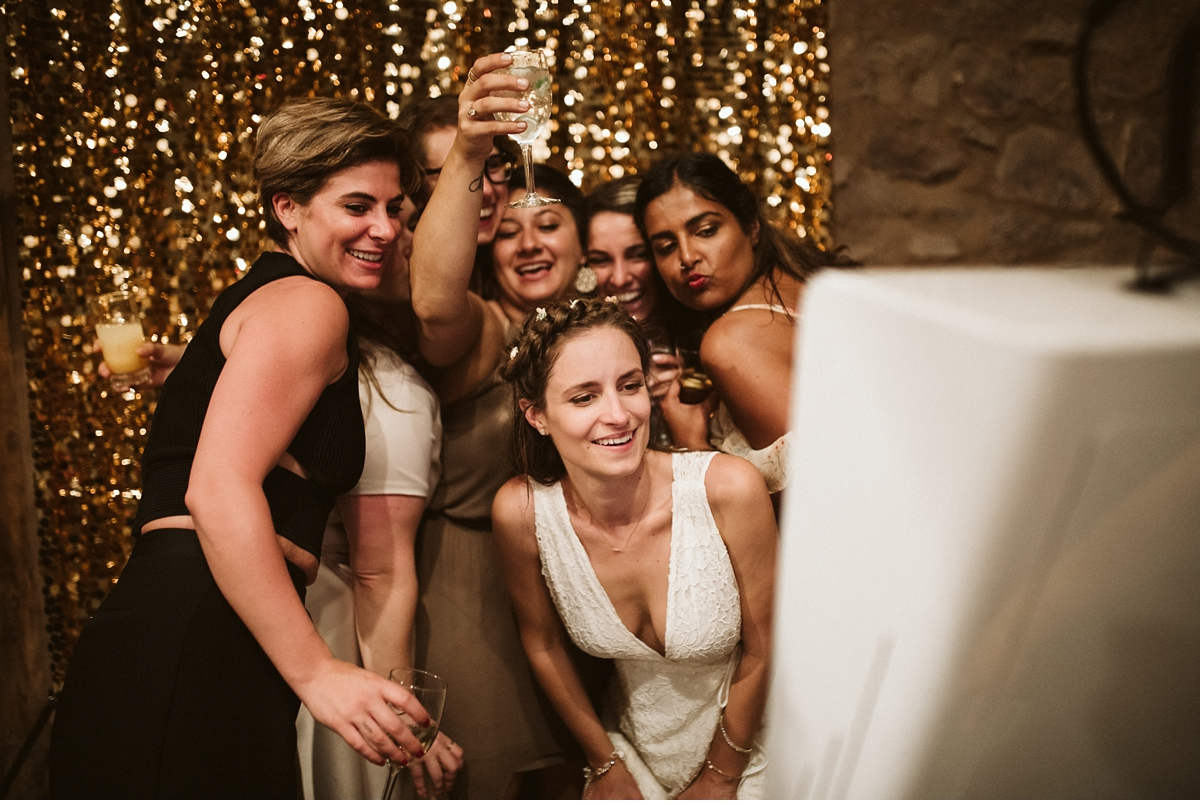 Bride and bridesmaids posing in photo booth at Willowwood Arboretum NJ