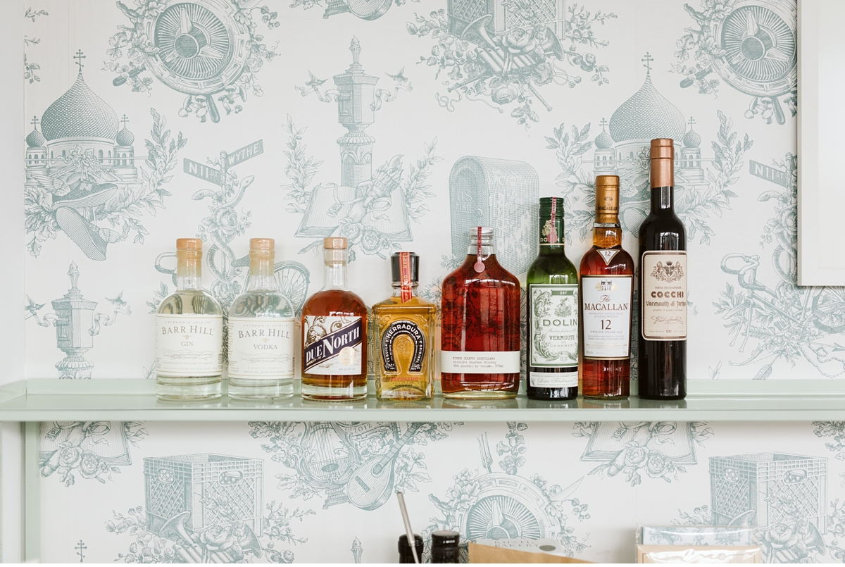 liquor bottles on shelf in hotel room at Wythe Hotel