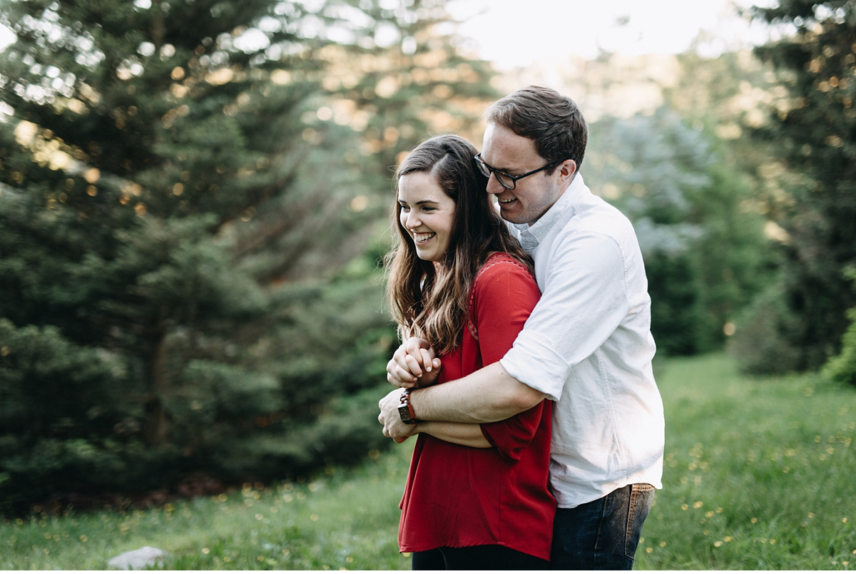 Couple laughing during casual Boston engagement session