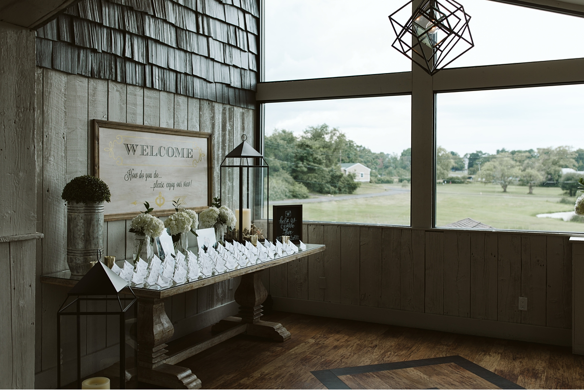 Place cards in front of picture window at Oceanview of Nahant by Carl Heyerdahl Photography