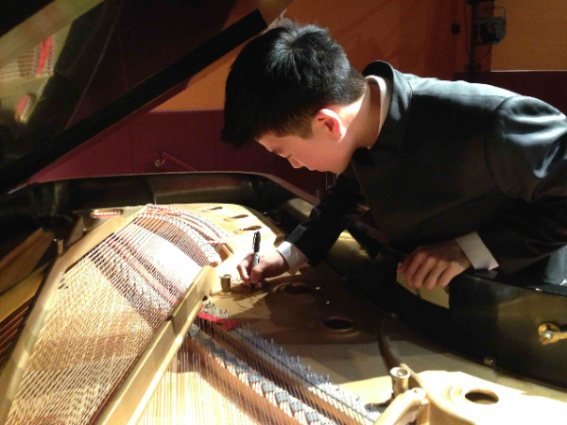 Jason Bae, Young Steinway Artist, signing the Steinway at Lower Hutt Little Theatre, New Zealand.