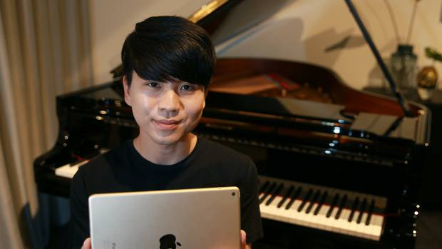 Jason Bae with a Steinway Spirio Piano which uses an iPad app to play like no piano you've ever heard - or seen - before. Photo / Doug Sherring