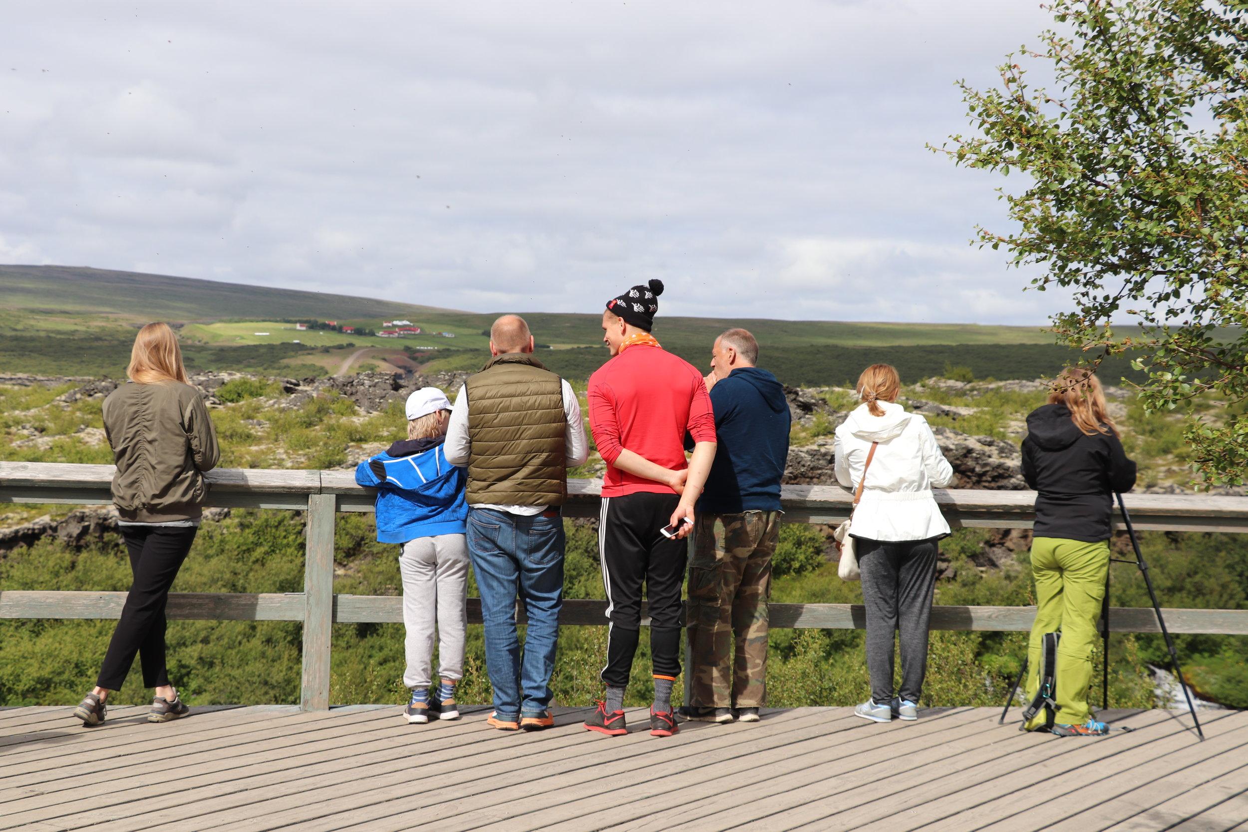 bridge-waterfall-iceland-tourists