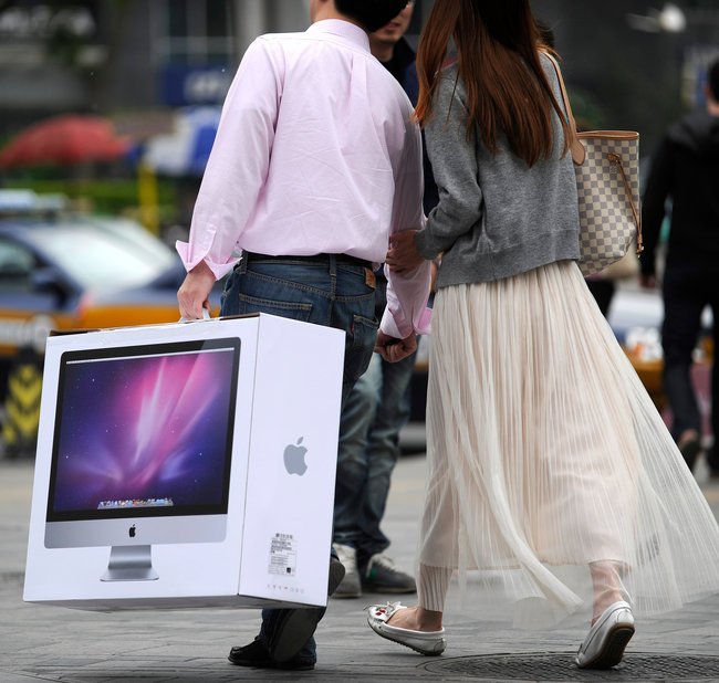 """ Could Apple be worth $1 trillion? It's conceivable. The $347 billion maker of iPhones and iPads became — if only briefly — the most valuable company in the United States when it overtook Exxon Mobil on Tuesday. Yet Apple's sales have been surging 80 percent a year, and its profit faster. What's more, it trades roughly in line with the growing stock market — and at less than half the price-to-earnings multiple it fetched in 2006, when revenue growth was much slower..""  