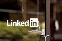 LinkedIn Corp., the first major U.S. social-media company to sell shares to the public, raised $352.8 million in an initial public offering after pricing its shares at the top end of the range.