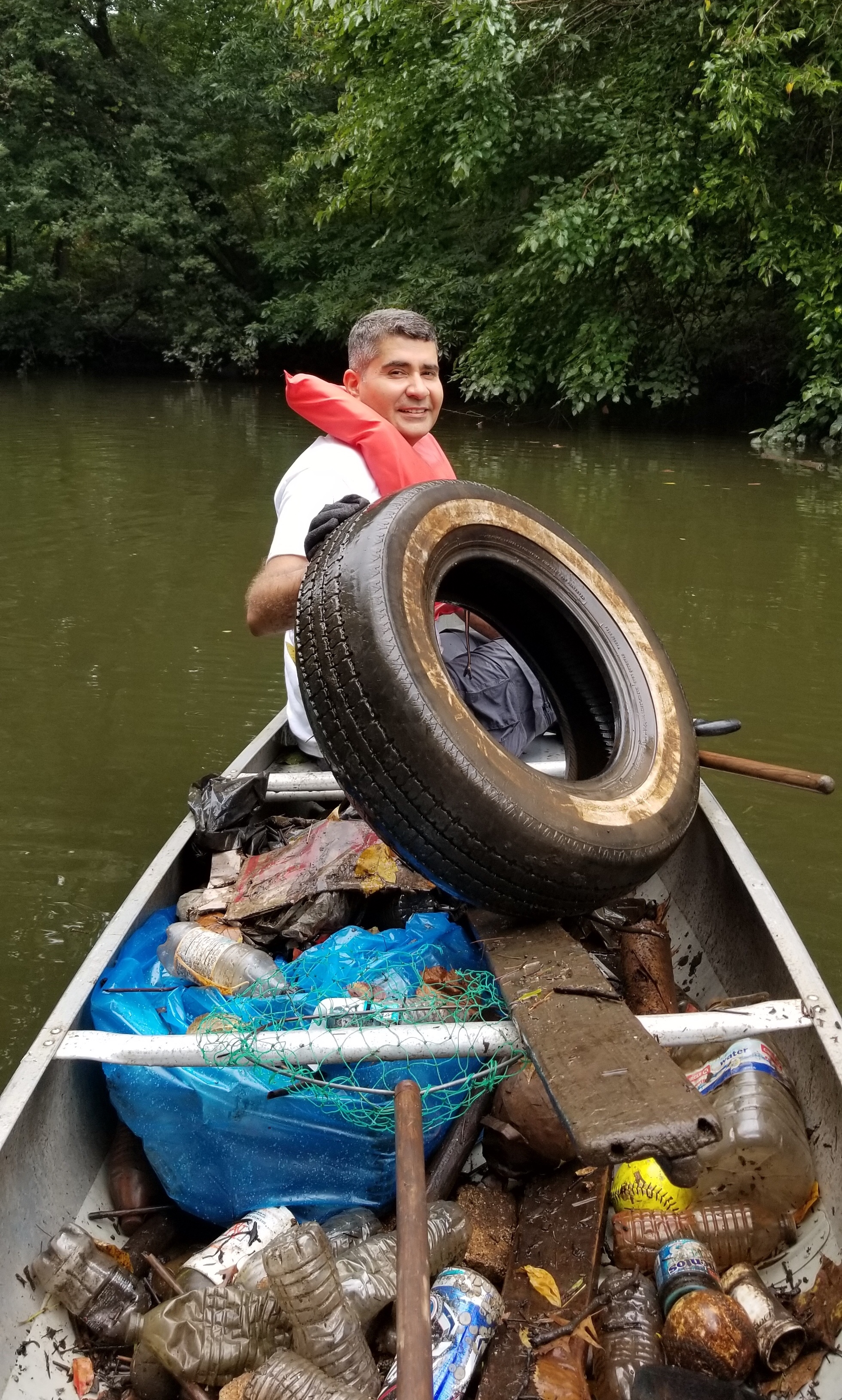 Pankaj's collection of trash, including the bulky tire!