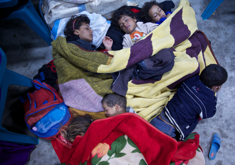 Syrian children sleep in Jordan as refugees after arriving from a multi day exodus from Syria.