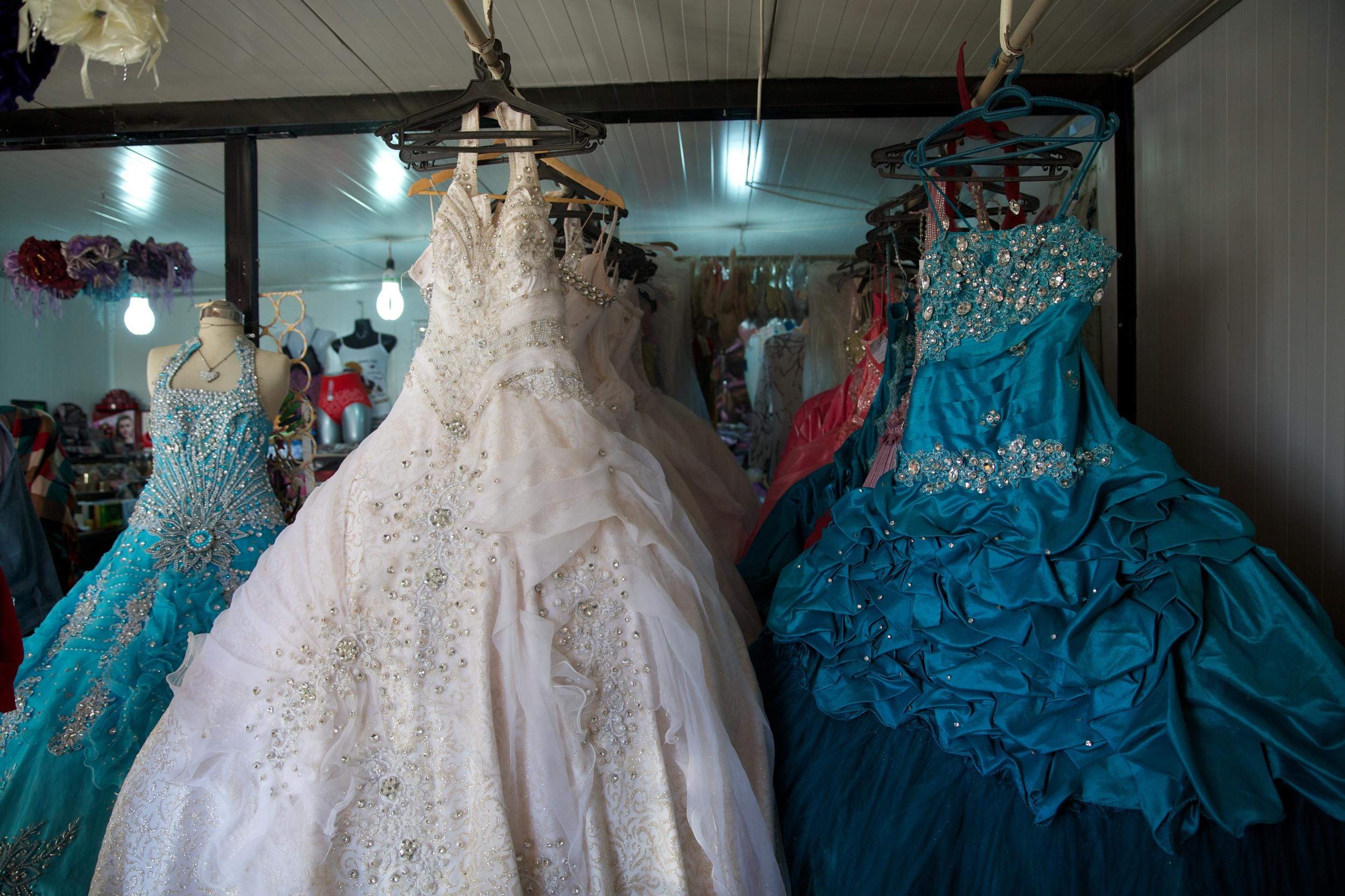 Wedding dresses for rent inside Zaatari refugee camp in Jordan.