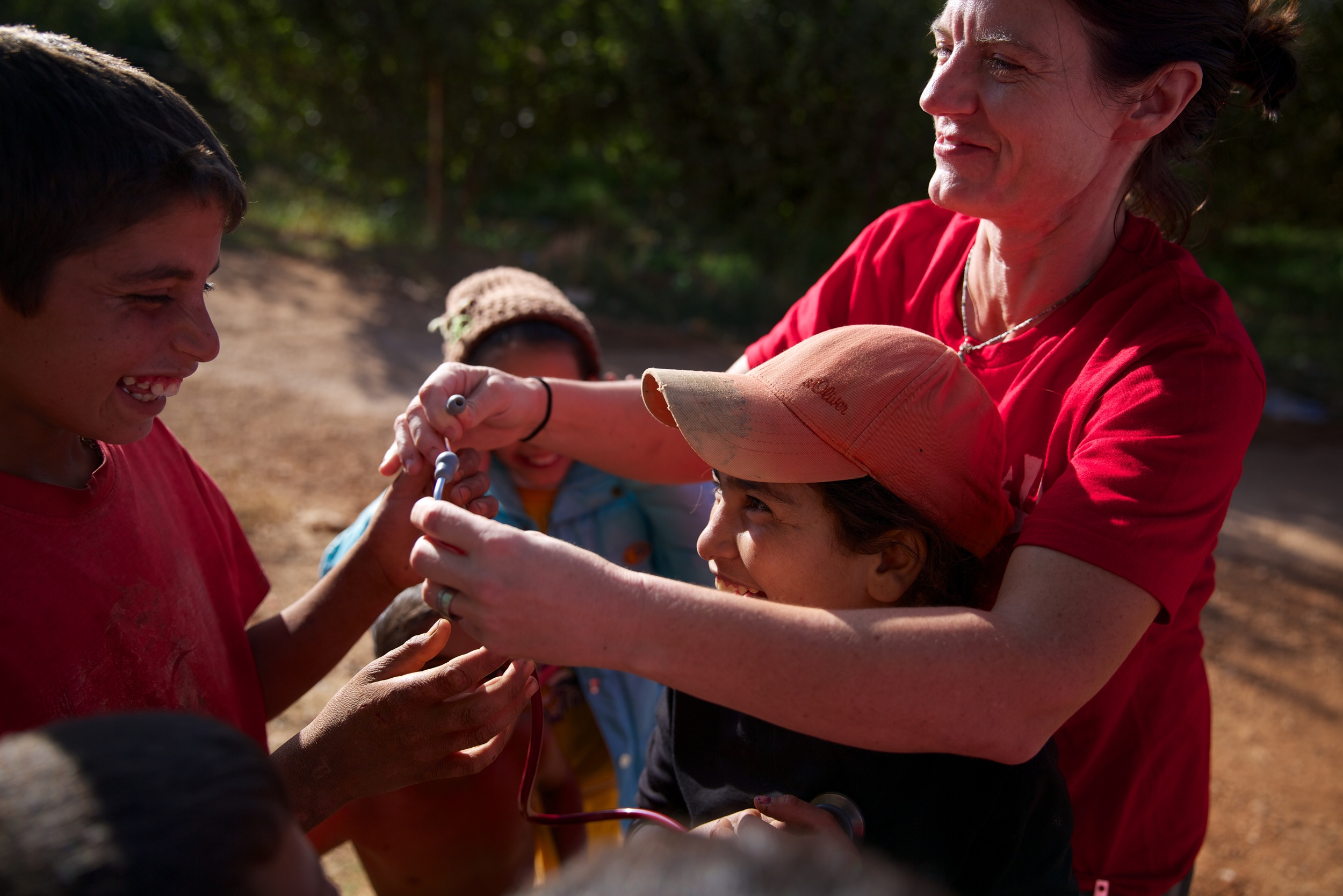 Martina Ford, a nurse from Portland, Oregon, shares her medical equipment with children at a refugee camp in Lebanon.