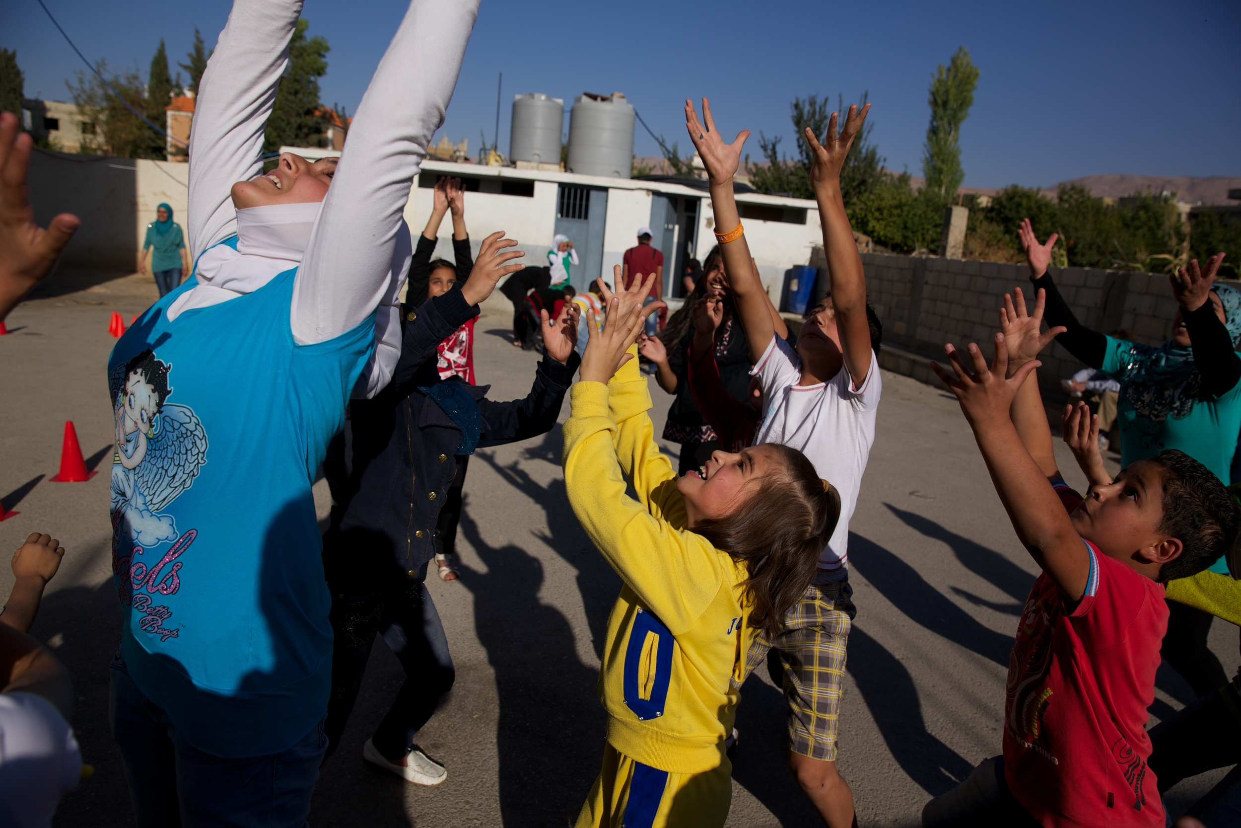 Syrian refugees play games at an after school clinic operated by Portland-based Mercy Corps in Lebanon.