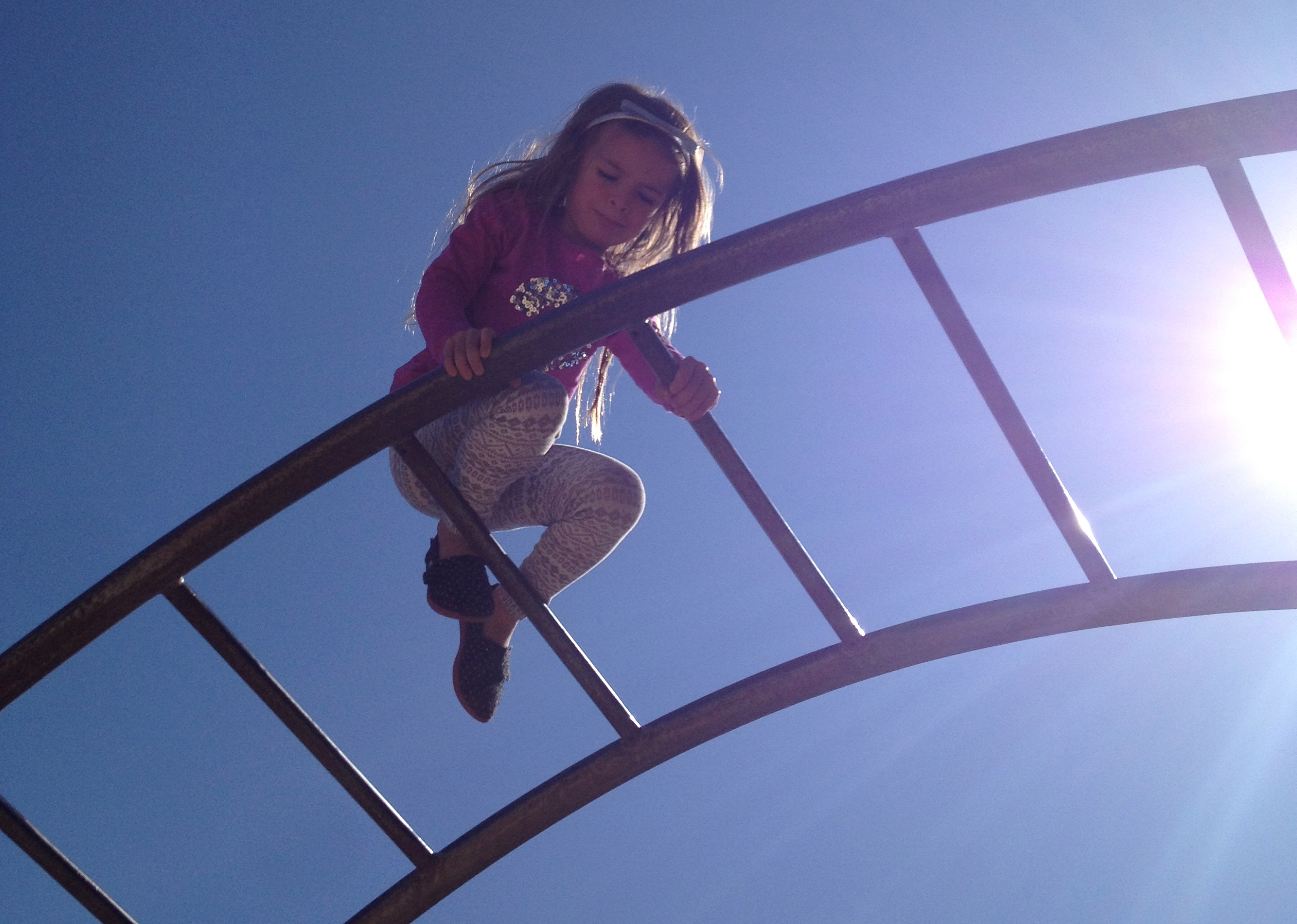 """this little rainbow climbing thing in Diamond Heights was like a million feet off the ground and terrifying. I got to go """"save"""" her from it after taking the proud pic. HA. I call it """"healthy fear,"""" which normally my overly brave girl doesn't have. ;)"""