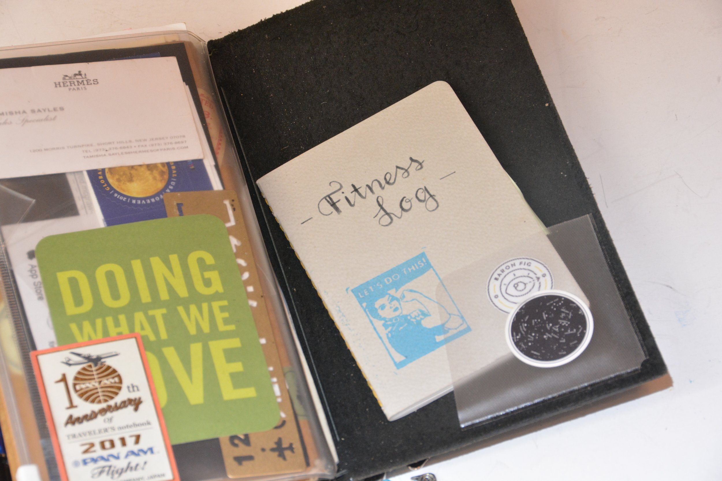 My zippered pouch serves to hold stamps an a few other items I need or want to have on hand, plus a reminder. Tucked inside a sticker pocket is my fitness log in a pocket size notebook by Baron Fig.