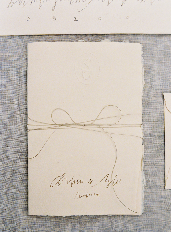 handmade-paper-deckled-edge-rough-ivory-pencil-hand-lettering-wedding-invitation-bow-twine.jpg