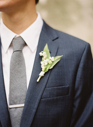 groom-navy-j-crew-suit-gray-tie-bar-clip-lily-of-the-valley-bout.jpg