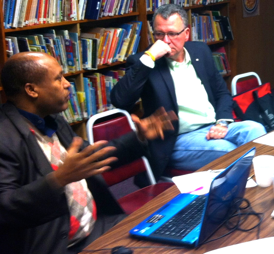 Rev. Dr. Getachew Kiros, President of ALMIA, explains to Minnesota South Mission Executive, Dr. William Utech, the challenges and opportunities that exist for mission and ministry among new immigrants in the Twin Cities and throughout the state of Minnesota.