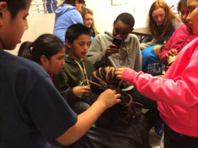 Crow children admiring a Ugandan student's hair