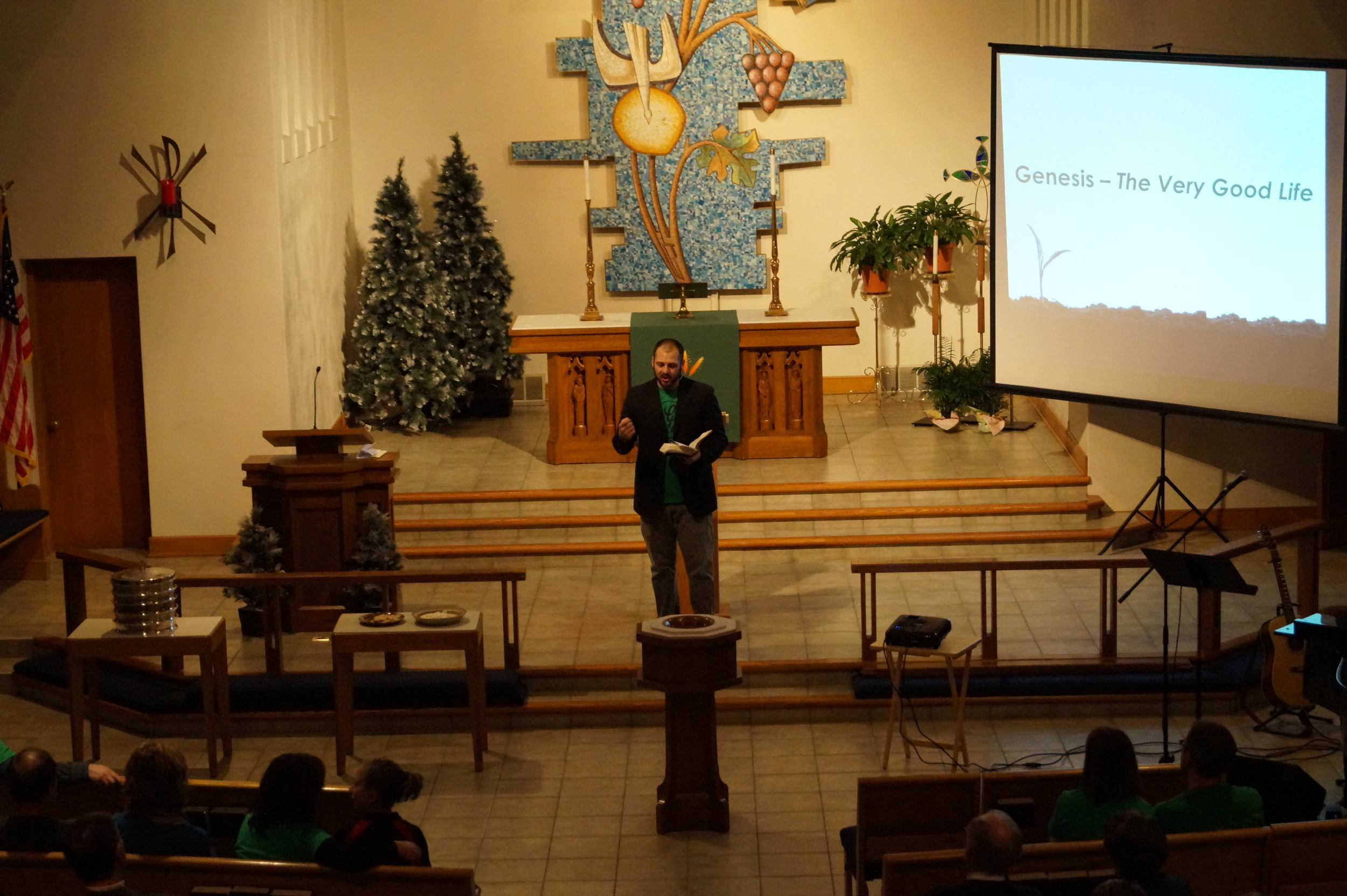 Pastor Dave Larson preaches at Genesis' launch service.